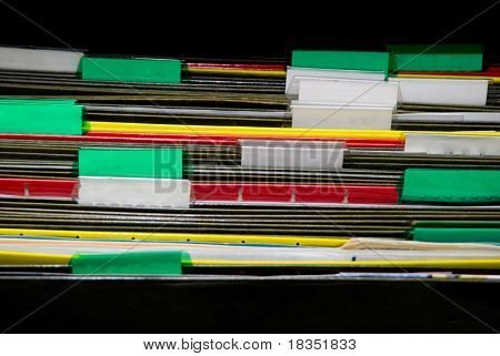 A set of organized file folders in an office