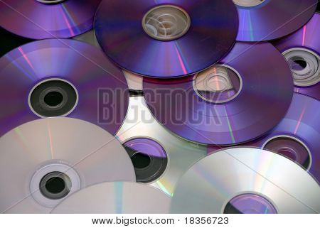 back ground of some colorful compact discs