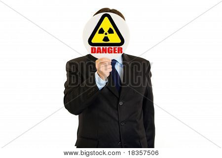 concept-radiation danger! Businessman holding radiation sign in front of face isolated on white