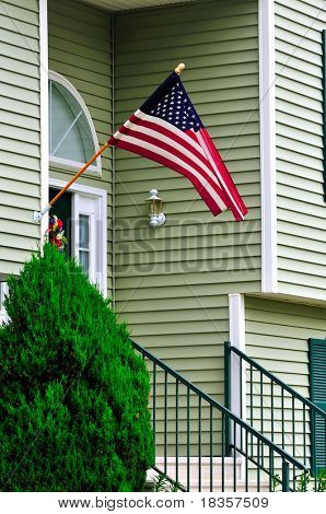 A new colonial house with American flag at the door
