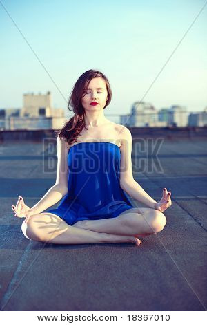 Young Attractive Woman Doing Meditation And Yoga