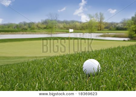 golf ball in beautiful countryside golf course