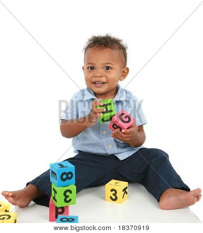 Adorable One Year Old African American Boy Playing Toy Isolated