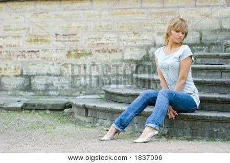 Girl Posing Near Wall