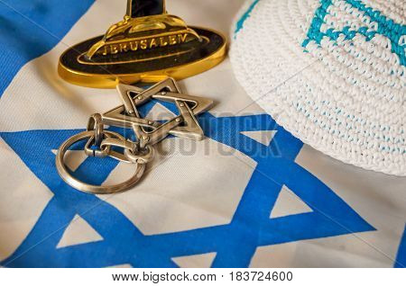 "Jewish symbols: customary religious kippah cap, a Star of David and a foundation of a menorah (a seven-lamp candelabrum) with the word ""Jerusalem"" written on it."