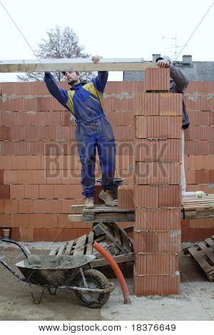 master bricklayer building-up one family house