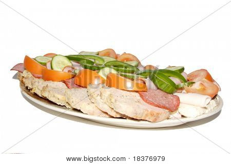 cold meat and fresh vegetables served on plate