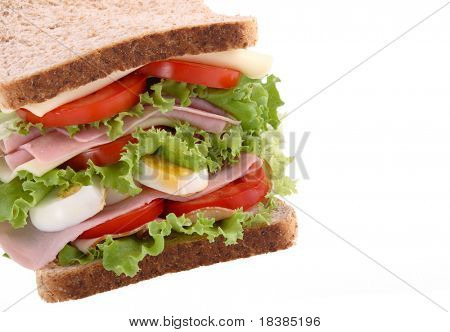 healthy sandwich with lettuce, tomato, ham and cheese