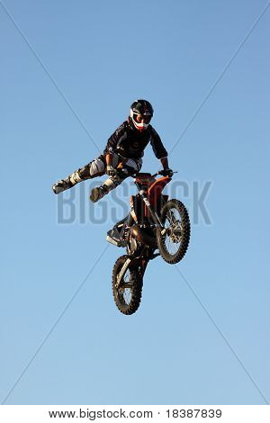 FARO, PORTUGAL - JULY 17: Acrobatic motorcycles jump show at Internacional motorcycle show July 17, 2010 in Faro, Portugal.