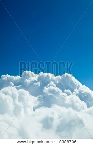 Blue sky with white clouds - looks like a mountain of snow