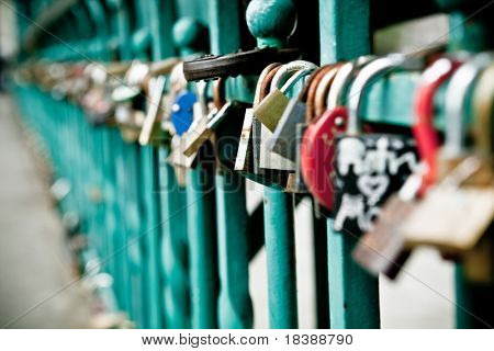 Padlock hanging on one of the bridges in Wroclaw