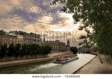 Touristic boat passing by Seine river in Paris, France.