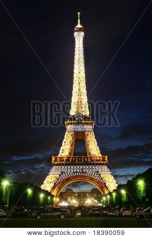 Vertical capture of famous Eiffel Tower at dusk with illumination on in Paris, France.