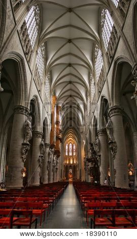 Vertical oriented image of catholic church interior located in Brussels, Belgium.