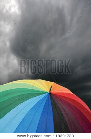 rainbow colored umbrella's in heavy rain to use as background
