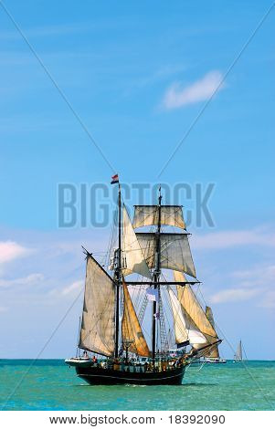 nostalgic pirate-ship sailing the caribbean on a sunny day