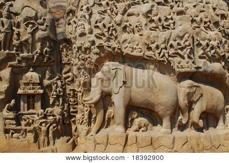elephants and people carved in stone wall hindu temple mahabalipuram, india