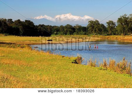 Landscape with river in Nepal with view on Himalaya