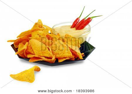 Nacho cheese tortilla chips with guacamole dip and chili peppers, isolated on white background