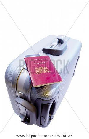 Trolley suitcase with passport and boarding pass ready to check in at the airport, isolated on white background