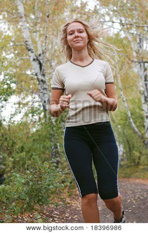 girl running in forest