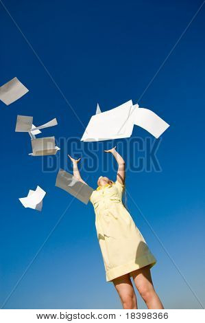 businesswoman throws up her papers