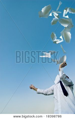 paperwork businessman throws up his papers