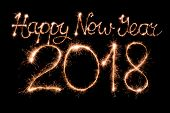 Happy new year 2018 text made from sparklers firework light poster
