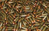 stock photo of uzi  - Many new bullets scattered as a background - JPG