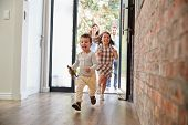 Excited Children Arriving Home With Parents poster