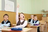image of students classroom  - Schoolchild behind desks at school - JPG