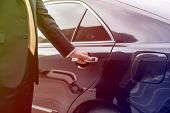 Businessman opening limo car door poster