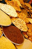 stock photo of mixed nut  - bowls with spices and nuts at indian market - JPG