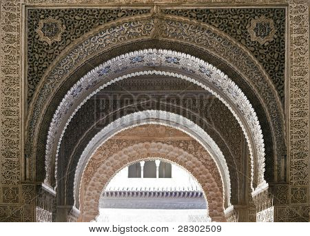 Arches in the Nazrid Palace showing different colour variations. Alhambra, Southern Spain