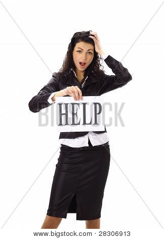 "Stressed business woman imploring for help holding a cardboard with the message ""Help"""
