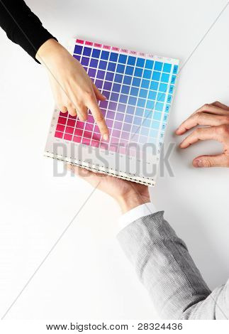 Woman Choosing Color From Color Scale, Top View