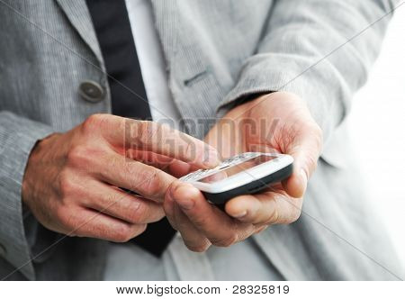 Businesman With A Smart Phone, Closeup Of Hands