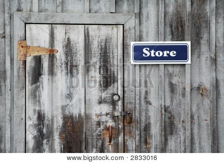 Store Sign On A Wood Building