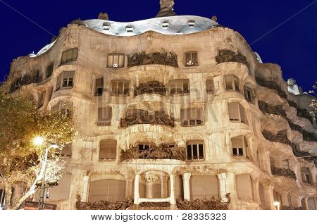 BARCELONA, SPAIN - DECEMBER 10: night view of Casa Milà better known as La Pedrera is a building designed by Antoni Gaudí and built during the years 1905–1910 in Barcelona - December 10, 2011