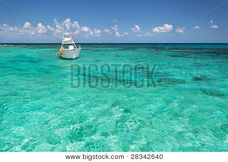 Snorkeling boat on turquise Caribbean Sea of Mexico