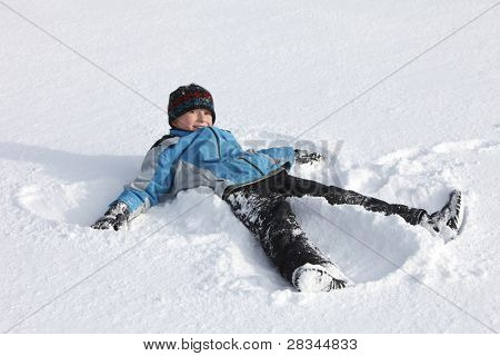 child makes a snow angel