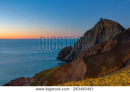 Rugged Coastal Cliffs By The