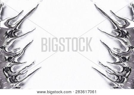 Liquid Metal Drips Image On