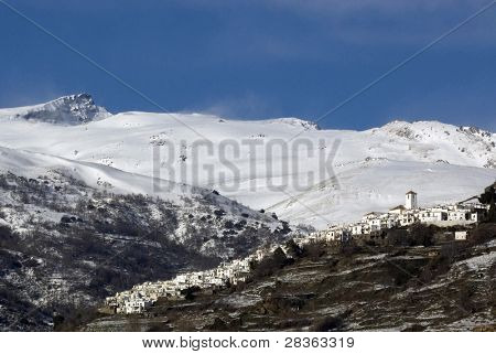 White towns under snowcovered high mountains