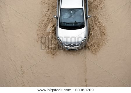 Car going through flood highway
