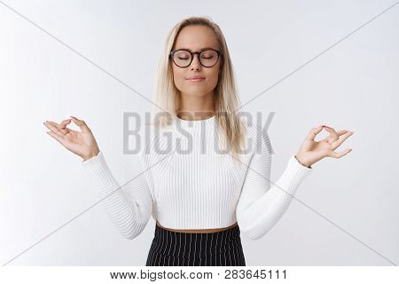 Female Entrepreneur Having Break Meditation