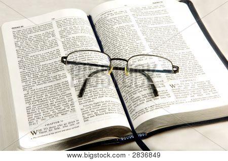 Bible Whit Eye Glasses.