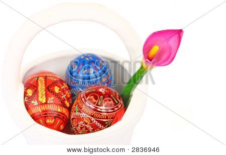 Three Easter Eggs And Violet Orchid In White Basket