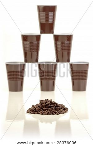Coffee beans and plastic cups.