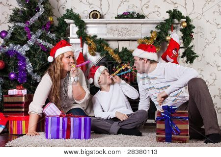 Happy Family With Christmas Gifts.